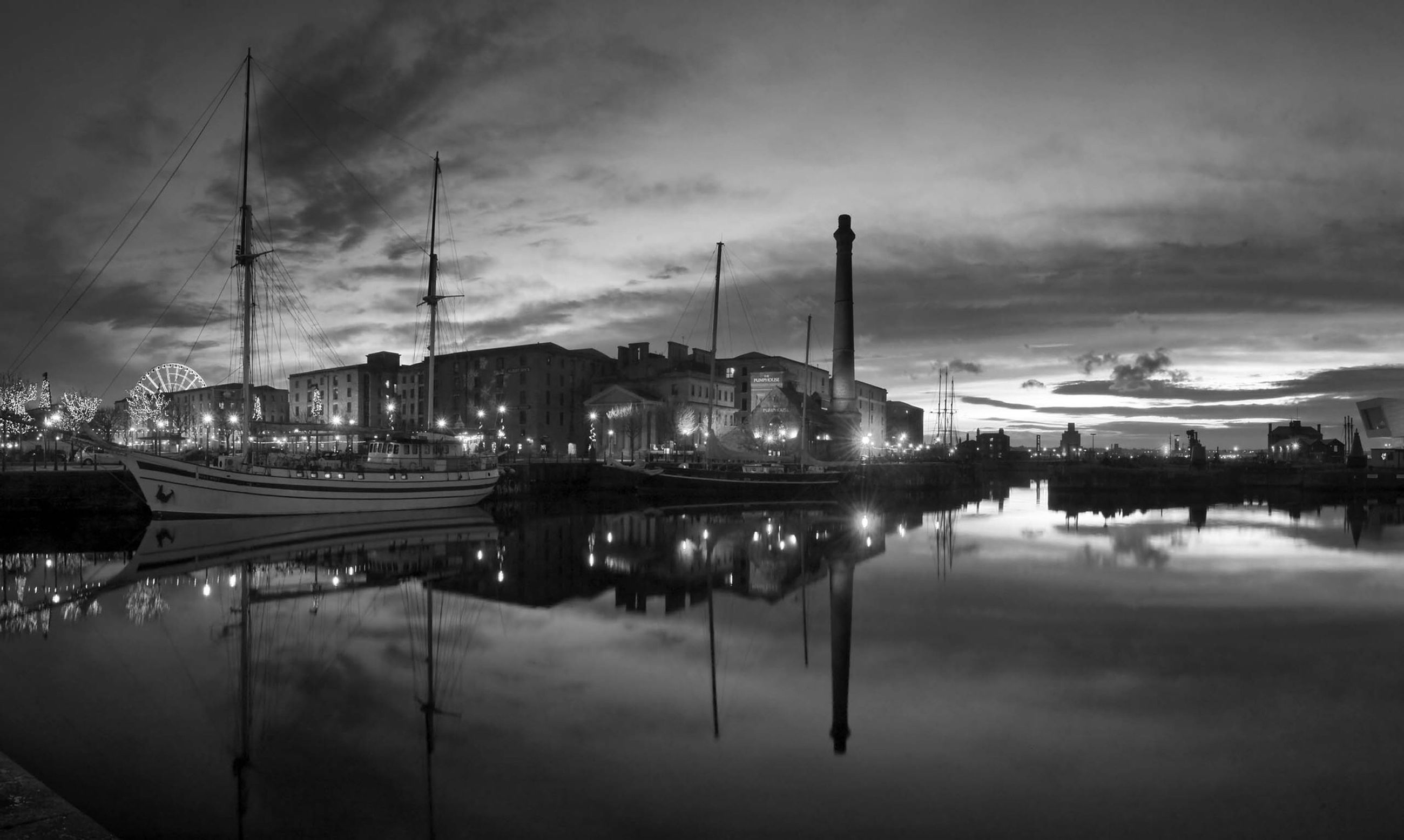 water, sky, reflection, cloud - sky, built structure, waterfront, architecture, transportation, building exterior, cloudy, harbor, illuminated, city, dusk, mode of transport, cloud, weather, river, moored, street light