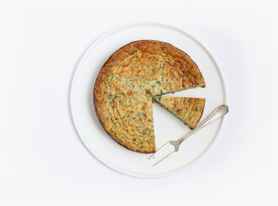 Crustless quiche | high res image available Cheese Cheese Tart Crustless Tart Food Food Photography Foodphotography Foodphotos Meal Overhead View Plate Quiche Savory Food Savory Tart Spinach And Feta Spinach Quiche Tart White Background