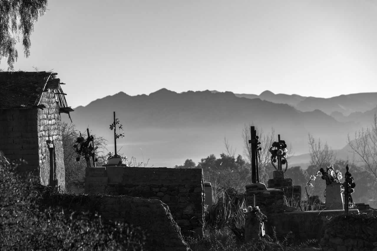 Black and white cemetery in rural Bolivia Architecture Arid Arid Climate Black And White Bolivia Building Exterior Cemetery Clear Sky Day Desert Espicaya Hill Hills Landscape Latin America Mountain Nature No People Outdoors South America Tourism Travel Travel Destinations Tree TUPIZA