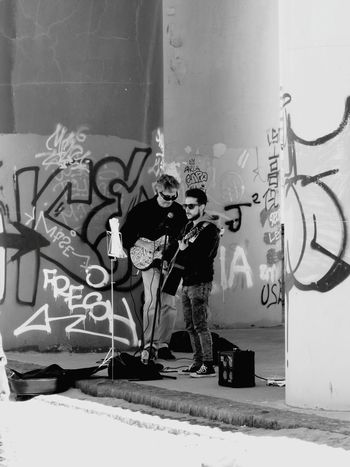 Graffiti Two People Spray Paint Street Art Full Length People Cool Attitude Standing Artist Adult Day Friendship Youth Culture Young Adult City Young Women Outdoors Togetherness Portrait Adults Only