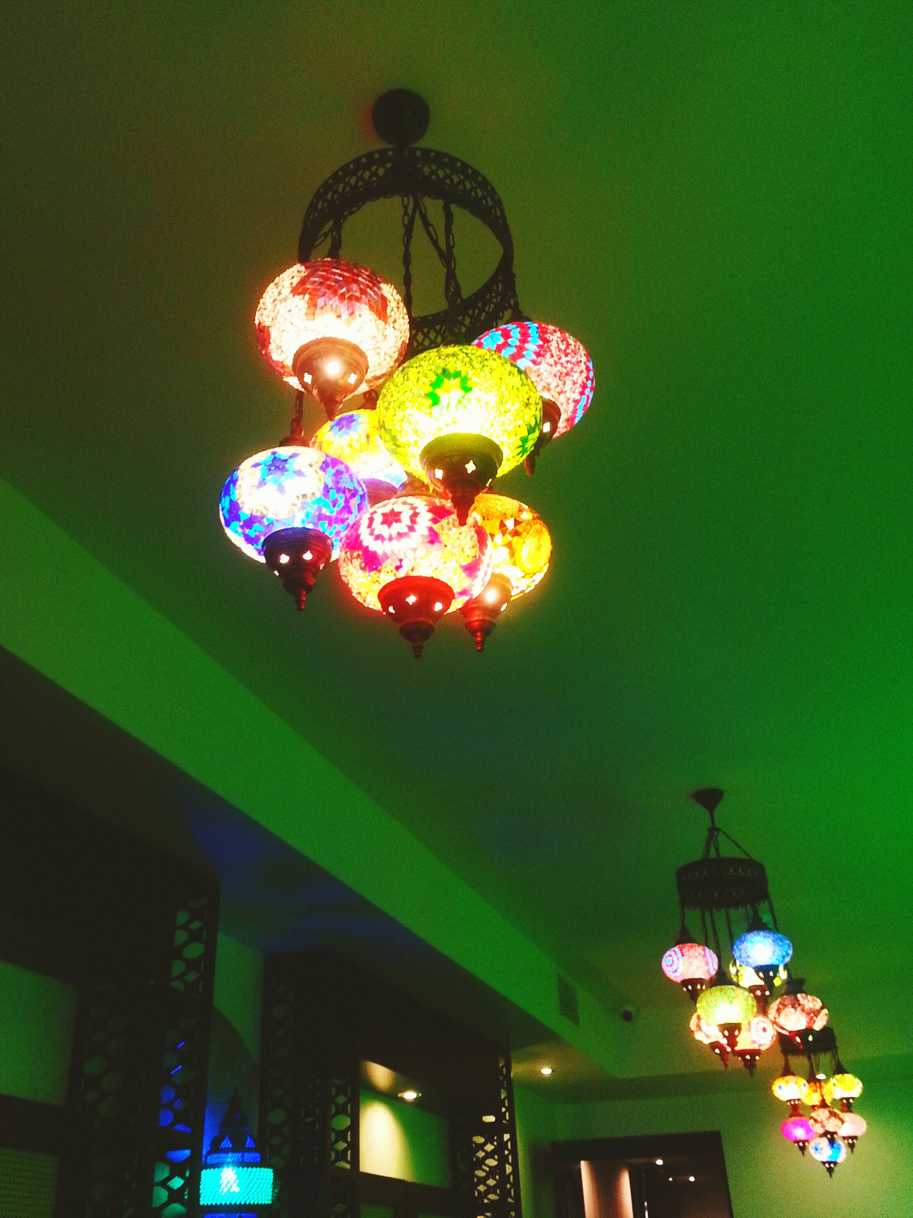illuminated, indoors, lighting equipment, hanging, decoration, multi colored, ceiling, low angle view, celebration, electric lamp, decor, christmas decoration, night, lantern, electric light, christmas, electricity, tradition, lamp, home interior