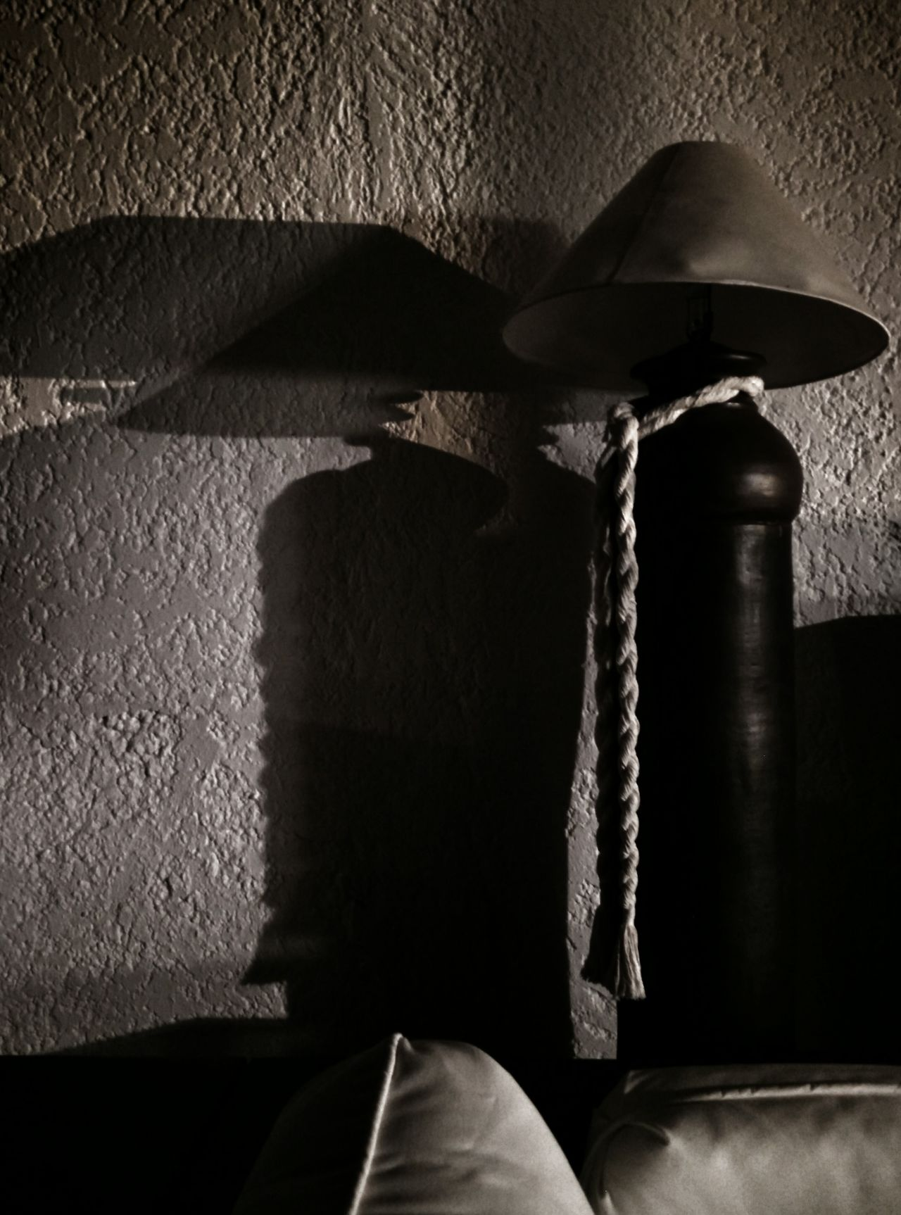 Shadow of Miyamoto Musashi. Large lamp that casts a shadow, like a shadow of a samurai with hat. Close-up Comfortable Contemplation Detail Focus On Foreground Hanging Hat Home Indoors  Japan Lamp Metal Metallic Miyamoto Musashi Music Occupation Rusty Samurai Shadow Shadow Of Miyamoto Musashi Single Object Still Life Textured  Wall Wall - Building Feature