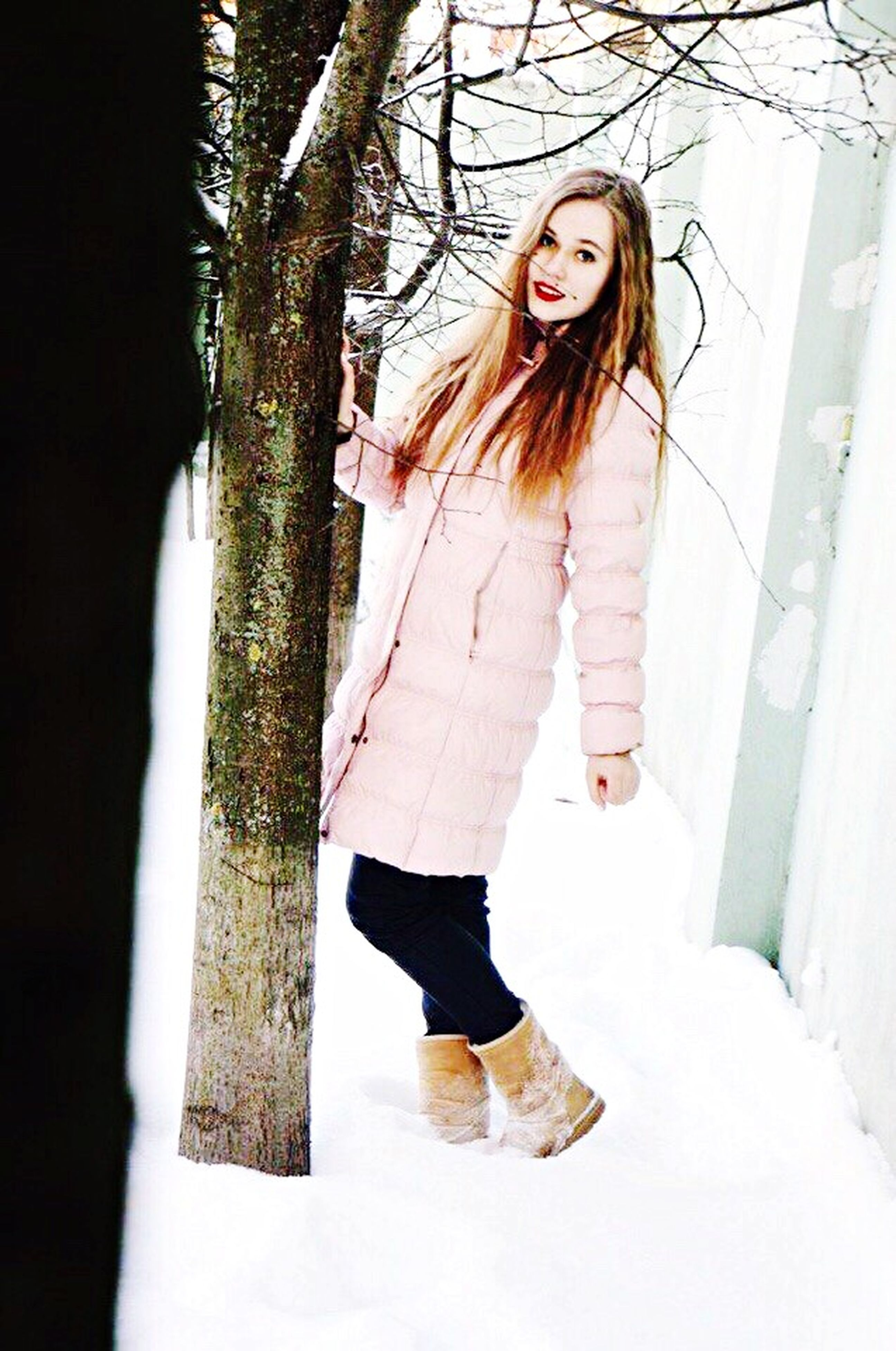 full length, lifestyles, young adult, standing, casual clothing, young women, leisure activity, winter, person, front view, long hair, snow, cold temperature, portrait, looking at camera, three quarter length, warm clothing