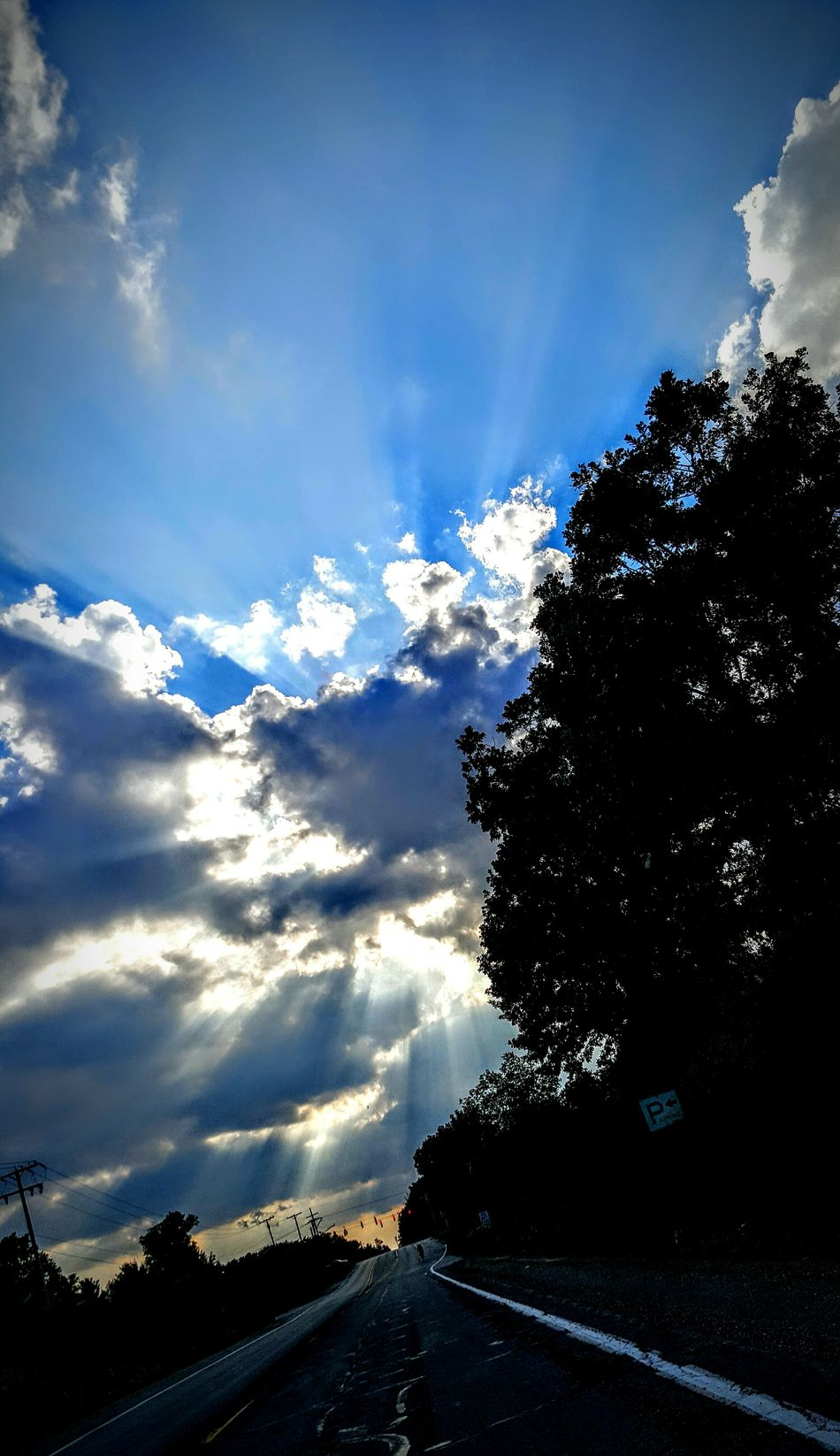 TakeoverContrast No Filter Calming Clouds And Sky Sun Through Trees Sun Through Clouds Person On Road Beautiful Sky Heavens Light Michigan Michigan Skies
