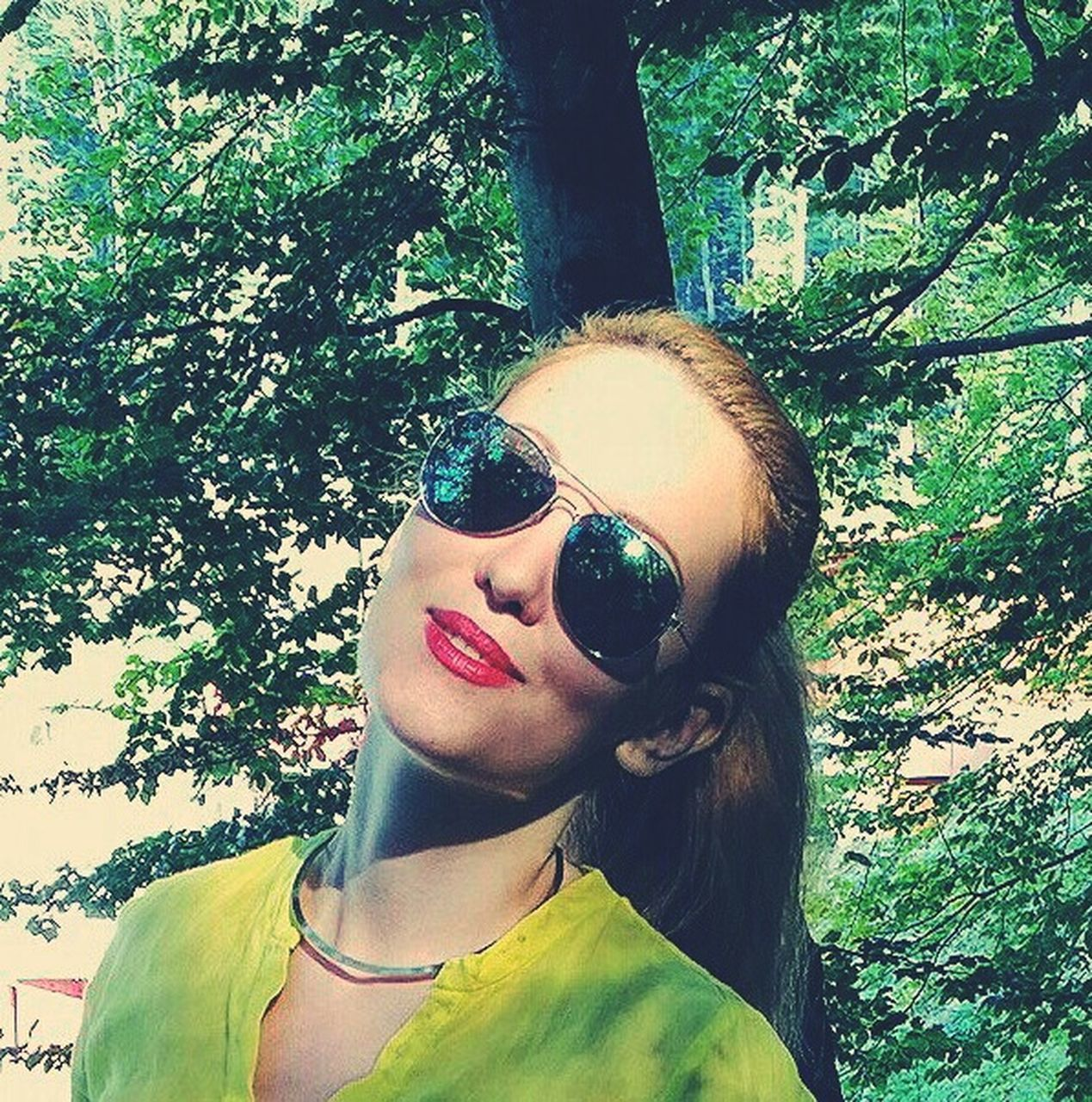 sunglasses, young adult, one person, young women, tree, head and shoulders, day, front view, real people, portrait, outdoors, headshot, looking at camera, standing, beautiful woman, lifestyles, smiling, red lipstick, one young woman only, people