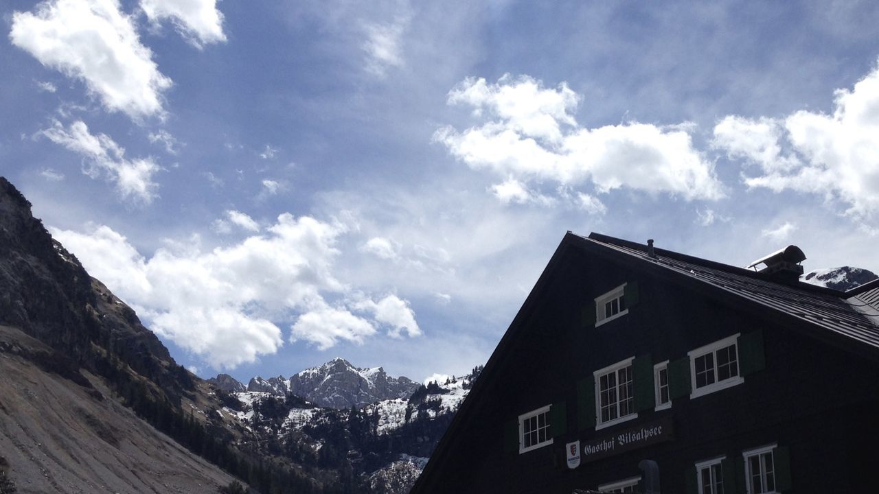 scenic view of sky, mountain and traditional house in the alps, vilsalpsee, tirol Architecture Building Exterior Clouds Detail Dramatic Sky Holiday House Life Light Mountain Nature Nature Outdoor Outdoors Roof Scenery Sky Snowcapped Mountain Spring Tannheimer Tal Tirol  Travel Vilsalpsee Window