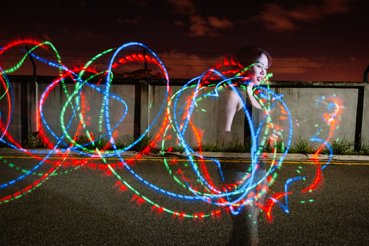 Arts Culture And Entertainment Colourful Cultures Defocused Focus On Foreground Full Frame Glowing Light Trails Long Exposure Long Exposure Shot Music Young Adult Young Women Q The Enhanced Human Women Who Inspire You Photography In Motion Human Meets Technology Envision The Future