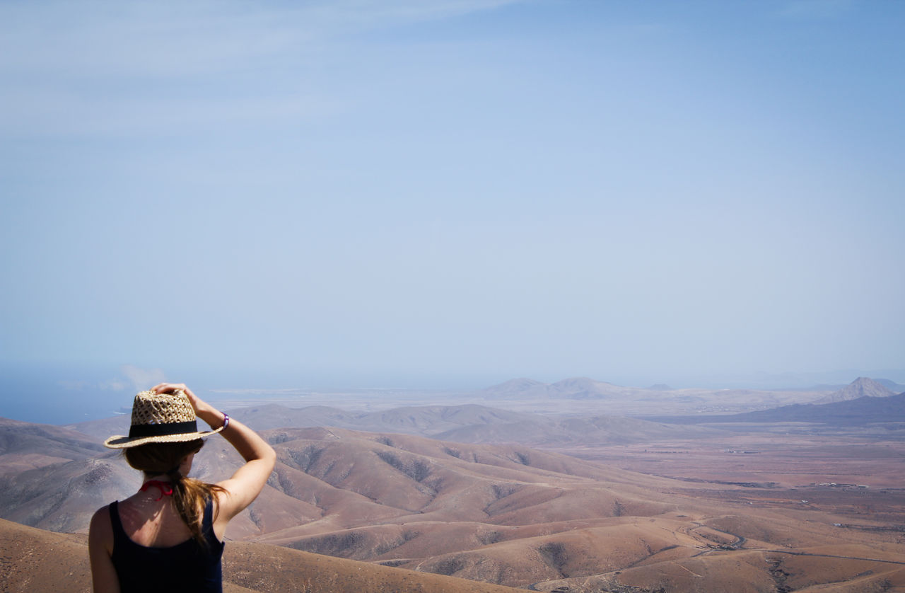 Woman Looking On Desert Landscape Against Sky