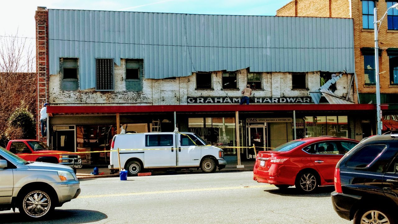 Transportation City Car Land Vehicle Building Exterior Mode Of Transport Stationary Built Structure Outdoors Day Architecture Demolition New Life Redevelopment Graham NC Old Brick Building Facade Building Downtown Small Town America Street Corner Streetscape Bricks In The Wall Brick Buildings Building Exteriors