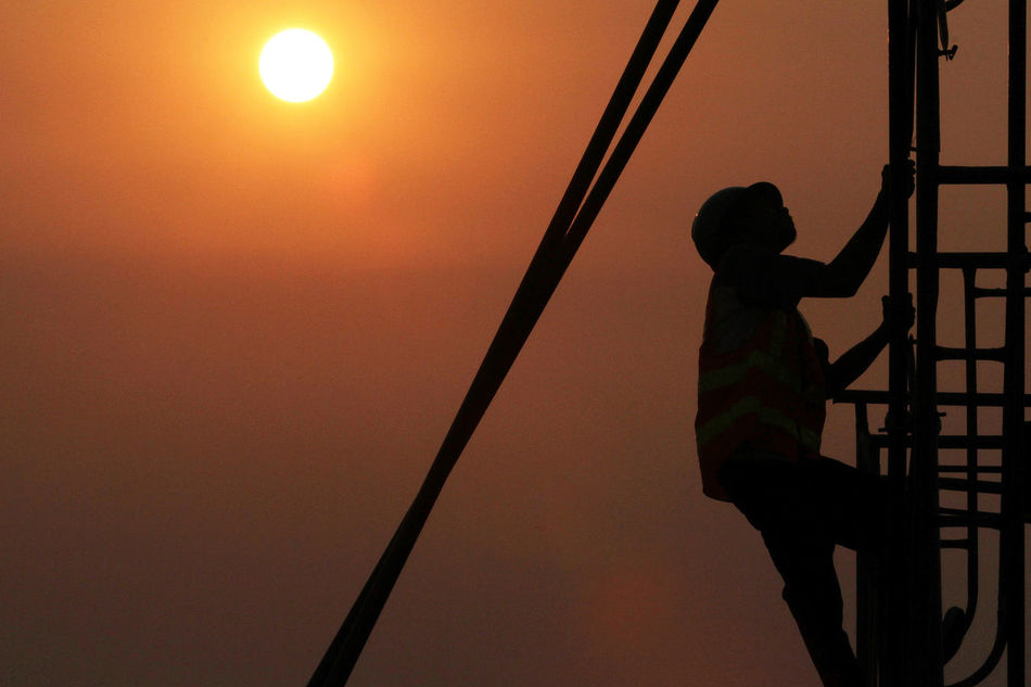 Beauty In Nature Boys Child Childhood Children Only Contruction Contructionwork Day Full Length Low Angle View Nature One Boy Only One Person Outdoors People Real People Silhouette Sky Sun Sunset
