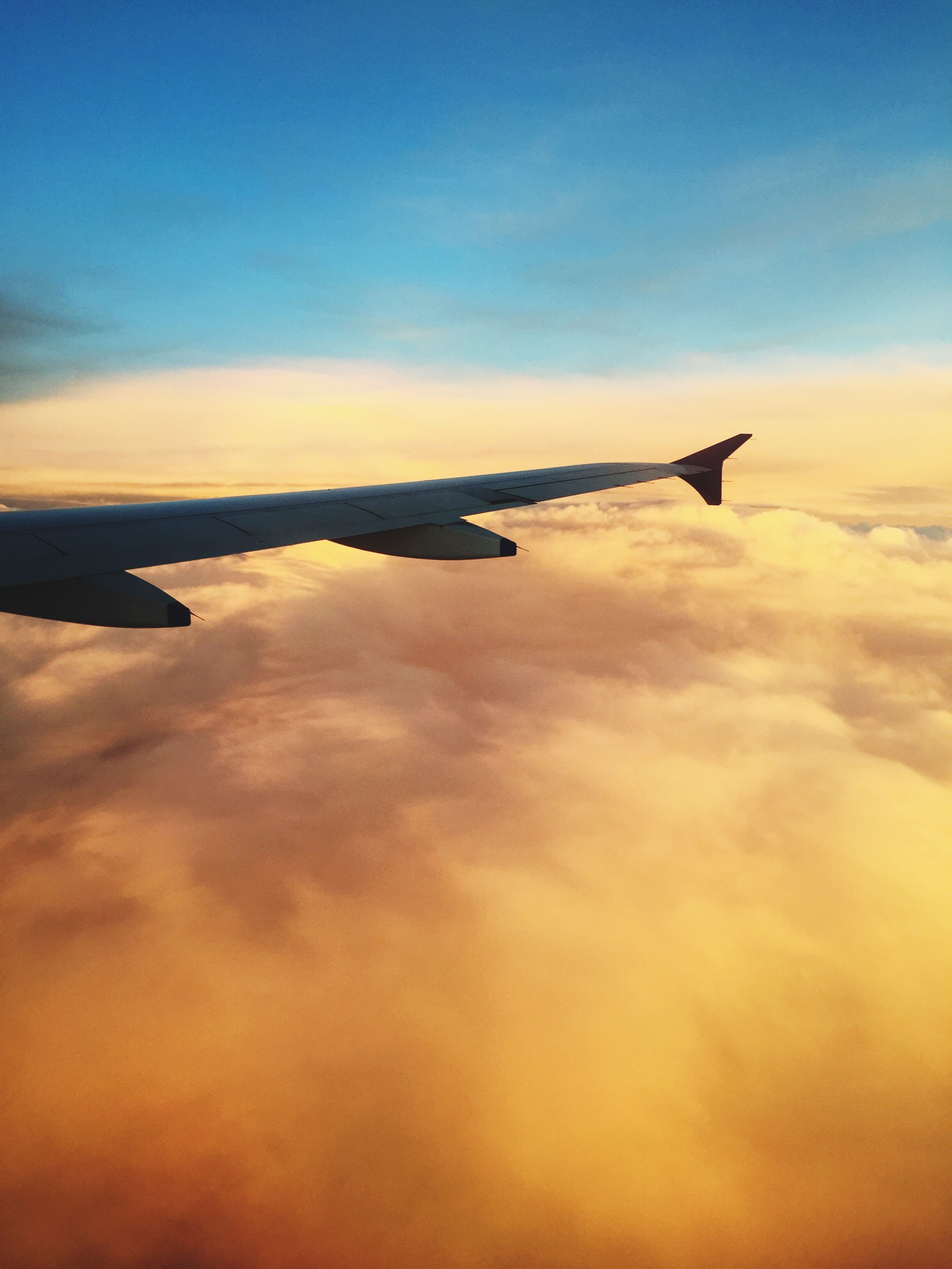flying, sky, airplane, sunset, cloud - sky, scenics, transportation, beauty in nature, air vehicle, cloud, nature, mode of transport, aircraft wing, tranquil scene, mid-air, cloudscape, part of, tranquility, travel, cropped