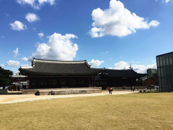 Cloud - Sky Korea Traditional Architecture Seoul, Korea Yellow Grass Blue Sky And Clouds Outdoors Roofs
