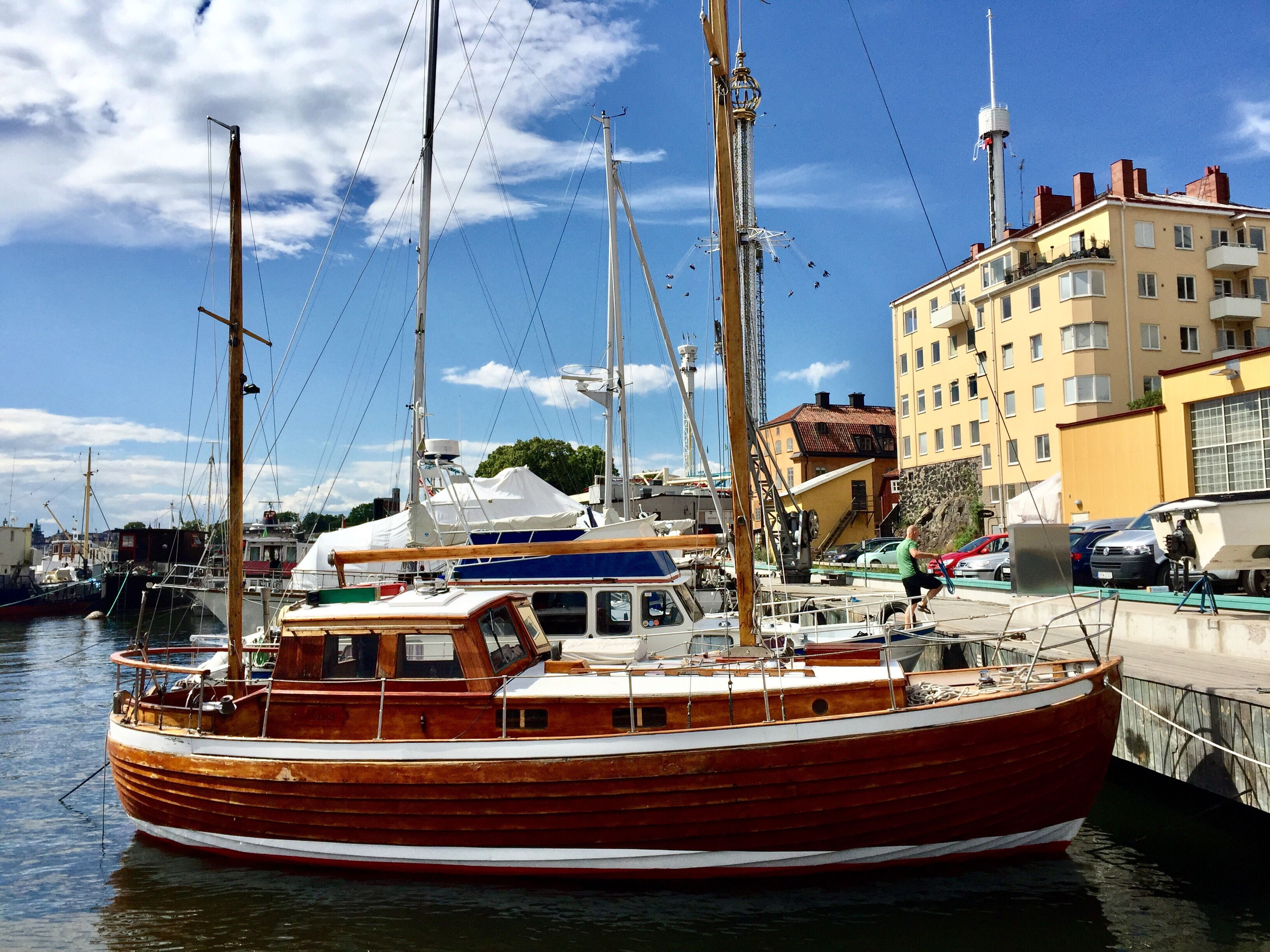 nautical vessel, mode of transport, transportation, moored, boat, building exterior, mast, sky, architecture, built structure, day, outdoors, water, waterfront, harbor, sailboat, no people, cloud - sky, sea, nature, yacht, city