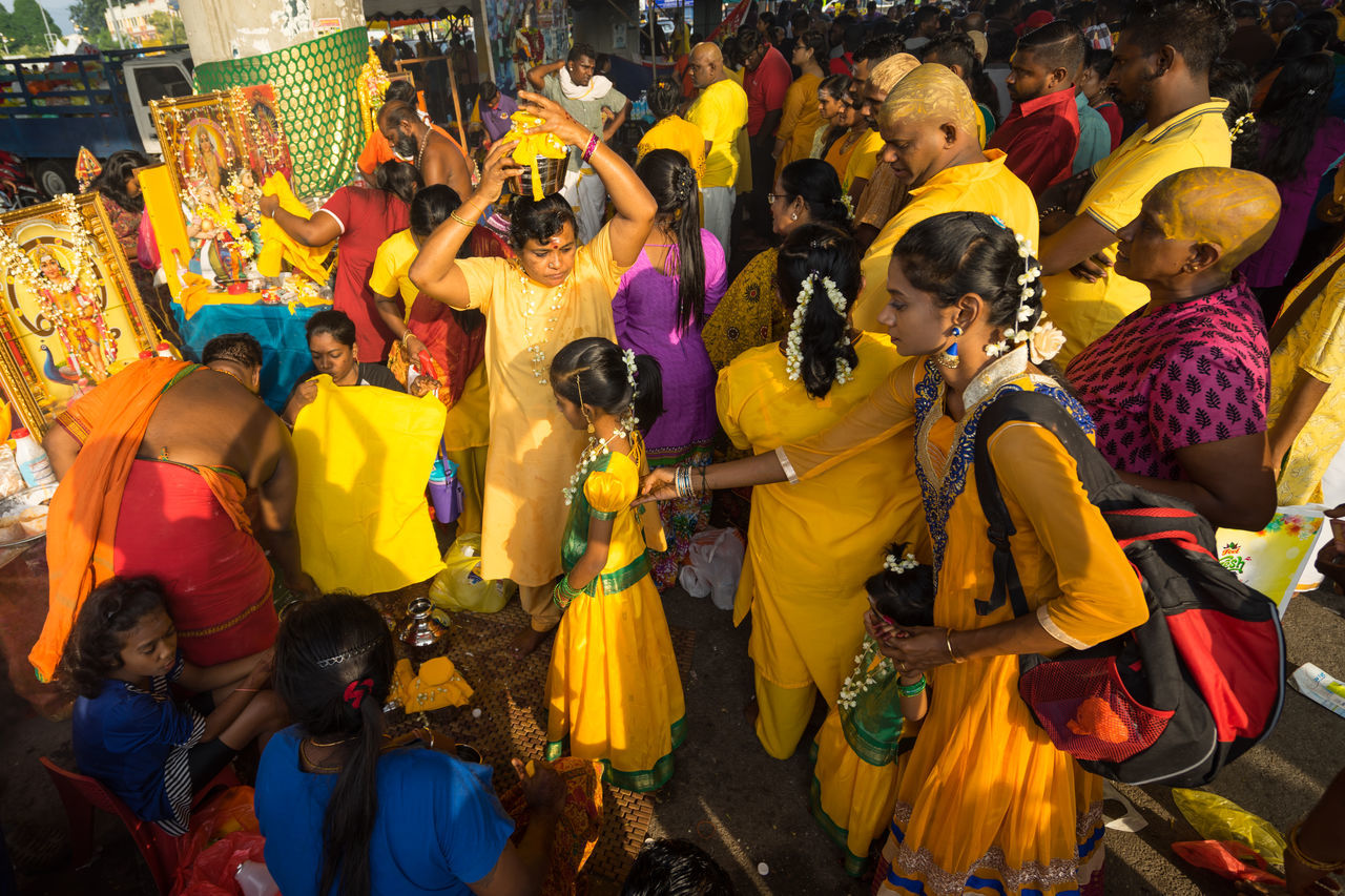 BATU CAVES, MALAYSIA - 9TH FEBRUARY 2017; Hindu devotees performing a pray session during Thaipusam festival in Batu Caves temple, celebrating Lord Murugan victory over the demon Soorapadman. Adult Adults Only Batu Caves -Malaysia Crowd Cultures Dancing Day High Angle View Hindu Culture Large Group Of People Lifestyles Men Music Outdoors People Performance Real People Sari Thaipusam 2017 Women
