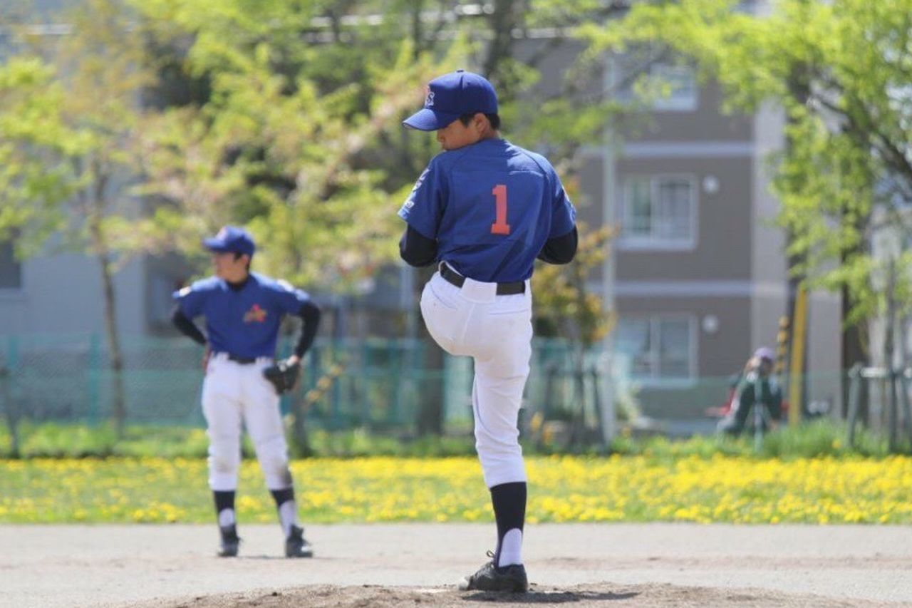 baseball - sport, two people, boys, child, baseball uniform, full length, sport, sports uniform, baseball bat, childhood, son, outdoors, batting, helmet, playing, children only, people, baseball player, standing, day, baseball glove, baseball cap, baseball team, adult, baseball pitcher, baseball helmet