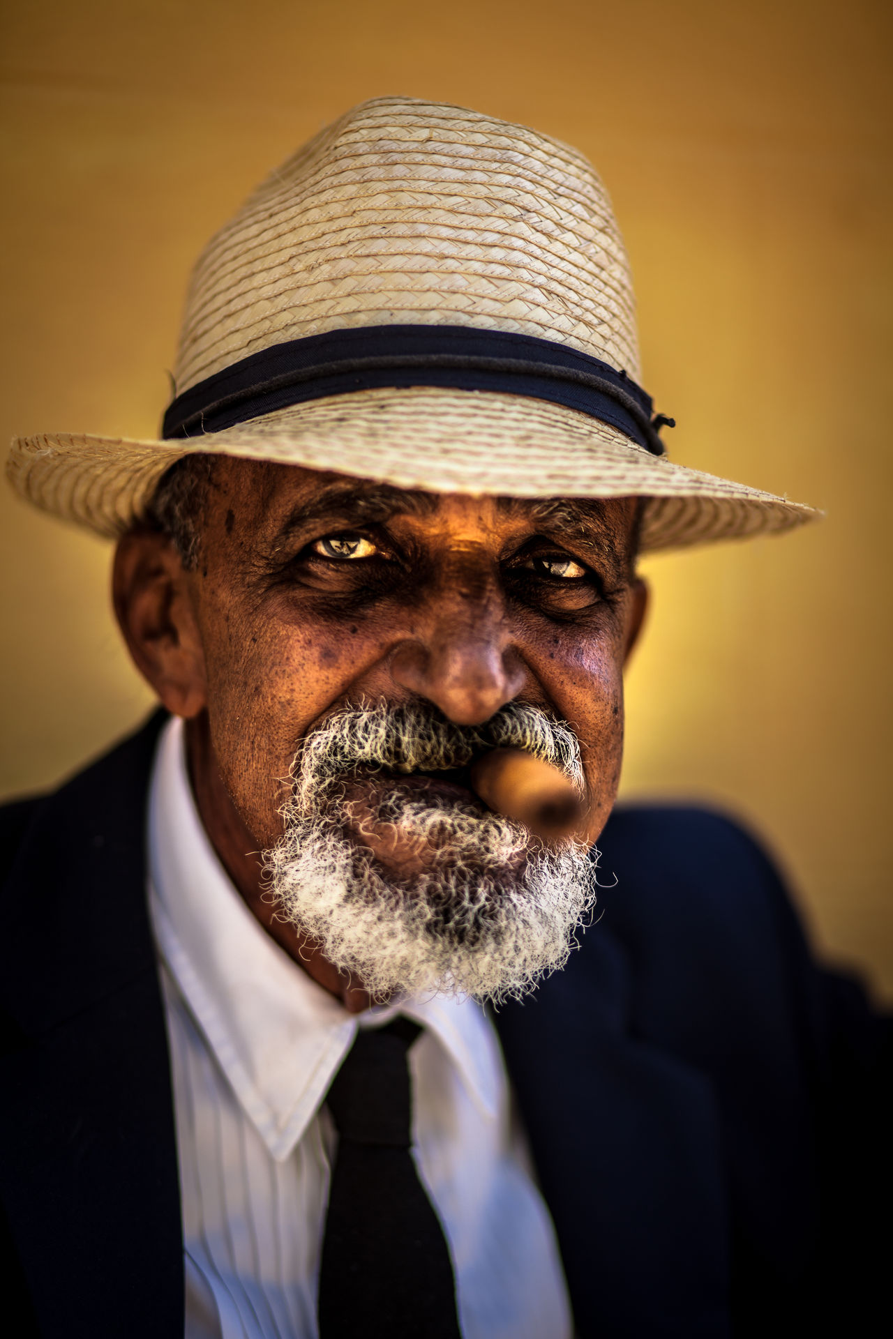 A cuban man poses for tourist' pictures. Cuba Cuban Man Portrait Sigar Straw Hat Travel Trinidad