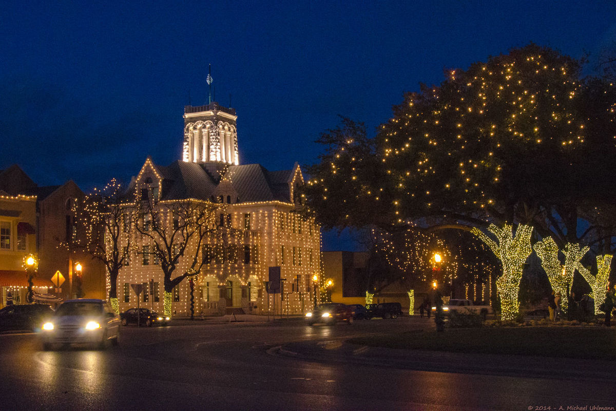 Every year, the Comal County Courthouse in the middle of New Braunfels is decked out with Christmas lights. Several festivities, like the Wassailfest, where merchants serve hot Glühwein to the Christmas shoppers and strollers and a Christmas parade prepare the people and visitors from around the state for the upcoming Christmas celebrations. The Courthouse in its Romanesque Revival style was designed by James Gordon and completed in 1898, and most of it, is still original, besides some doors and the roof that have been replaced over the years. In 1991 it was designated a Recorded Texas Historic Landmark. Christmas Christmas Decoration Christmas Lights Comal County Courthouse Illuminated New Braunfels Night No People Te Tree