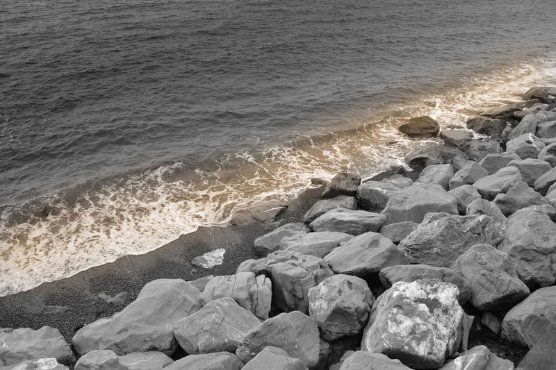 Sea Shore Beach Nature Water Pebble Wave Beauty In Nature Outdoors No People Power In Nature Pebble Beach Tranquility Day Motion Scenics Landscape