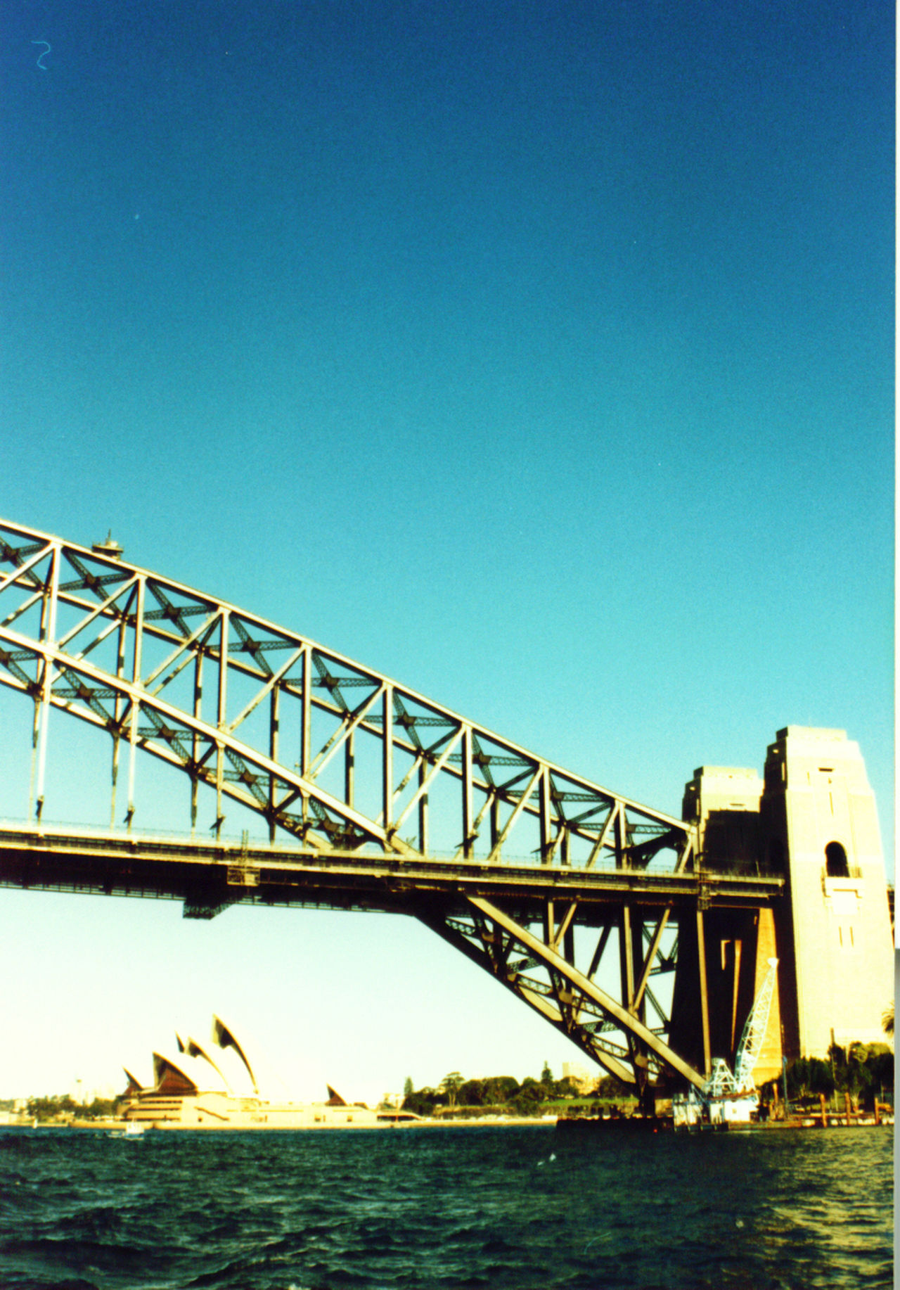 Architecture Australia. Blue Bridge Bridge - Man Made Structure Building. Built Structure Clear Sky Copy Space Day Engineering Holidays. Metal Opera House. Part Of Sea Sydney. Syney Harbour Bridge. Travel Water Waterfront