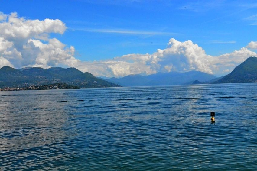 Stresa Italy Adventure Beauty In Nature Blue Cloud - Sky Day Leisure Activity Lifestyles Men Mountain Mountain Range Nature One Person Outdoors People Real People Scenics Sea Sky Swimming Tranquil Scene Tranquility Vacations Water Waterfront