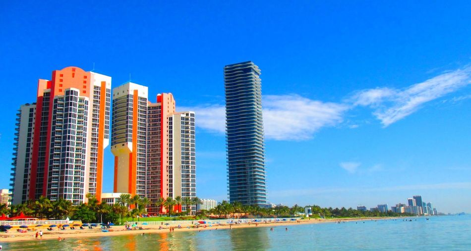 Beach day in Sunny Isle Florida #floridabeachlife #sunnyIsleFlorida Architecture Modern Outdoors Residential District Skyscraper Tower Water Reflections