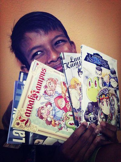 He loves read those comics! Enjoying Life