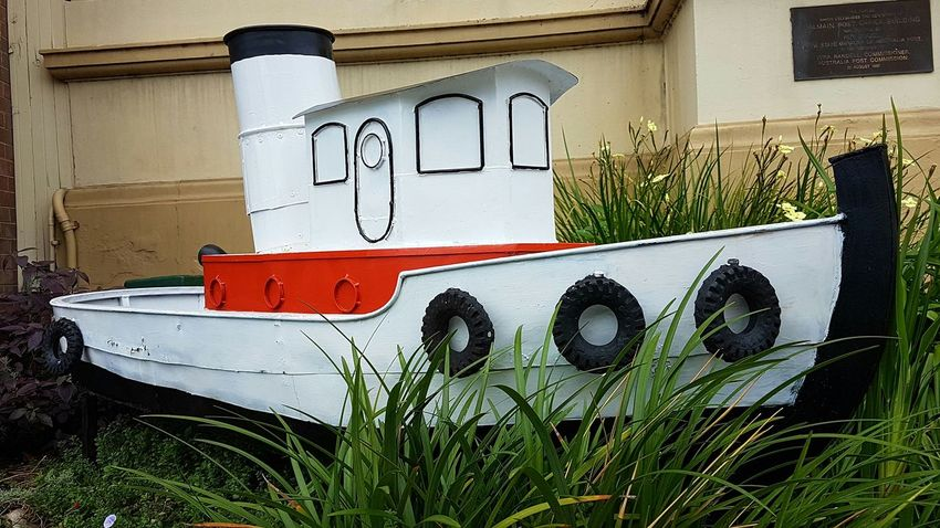 Red No People Day Built Structure Building Exterior Flower Outdoors Architecture tugboat garden art art Balmain Rozelle boat sculpture model boat toy boat