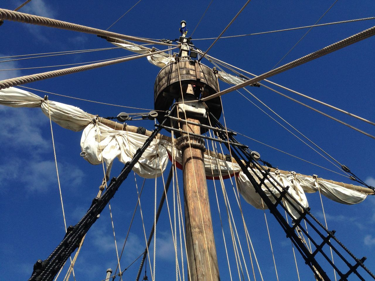 low angle view, mast, blue, day, outdoors, sky, no people, cable, clear sky, rigging, travel destinations, tall ship, nautical vessel, sailing ship