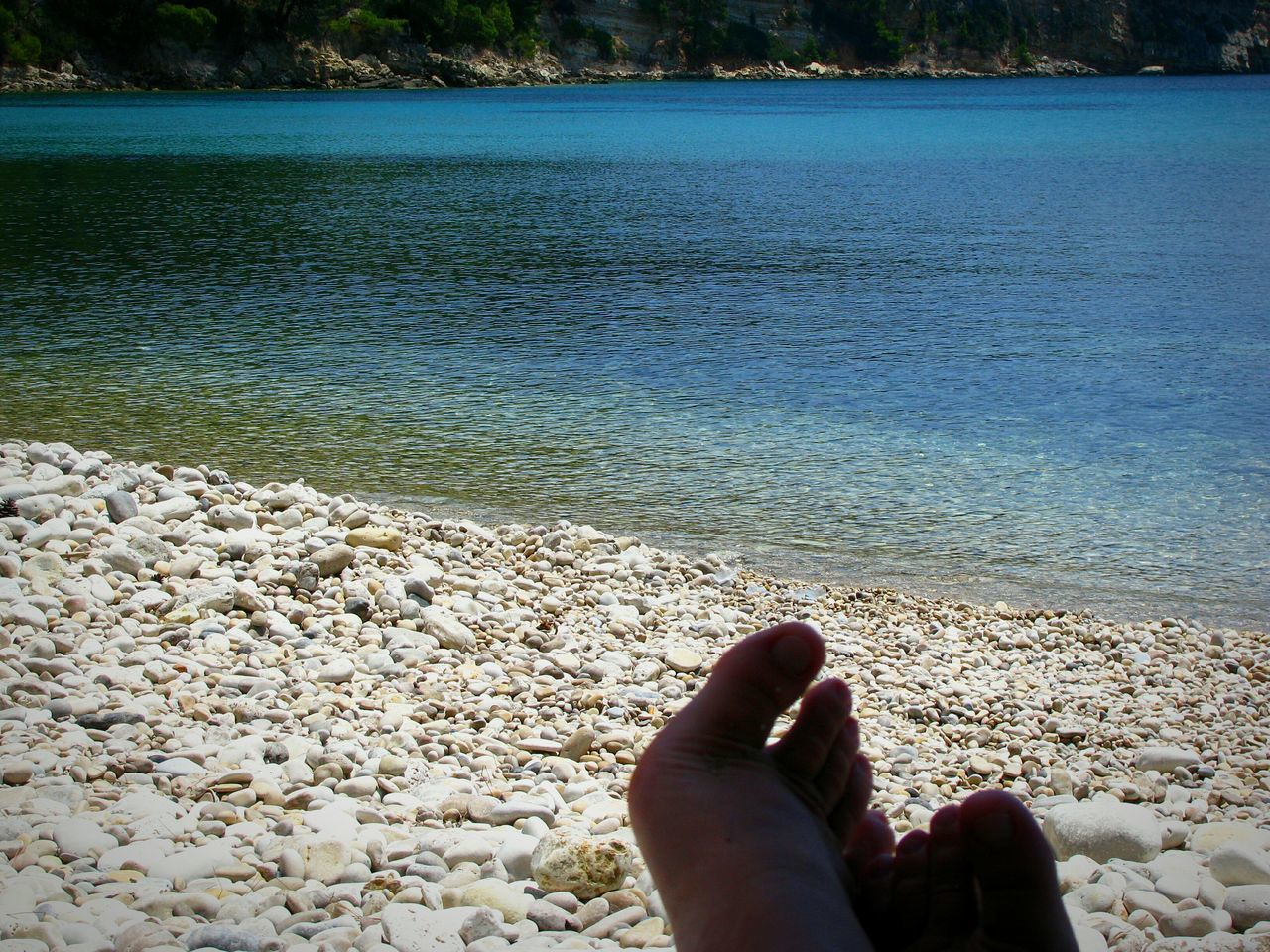 Relaxing Beach Beach Photography Blue Sea Greek Islands Water Human Body Part Human Leg Lifestyles Leisure Activity Nature Beauty In Nature Pebbles Pebble Beach Scenics Greece Sea Crystal Clear Waters