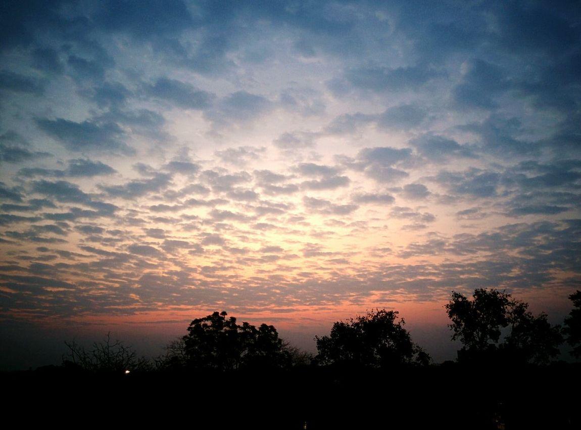 a new dawn Sunrise Clouds Tinge