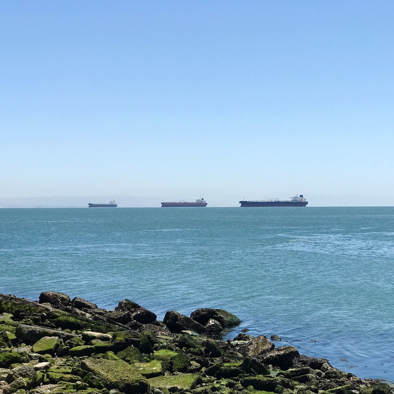 Sea Water No People Nautical Vessel Day Nature Transportation Horizon Over Water Outdoors Tranquil Scene Mode Of Transport Clear Sky Scenics Tranquility Beauty In Nature Blue Sky Ships In The Bay