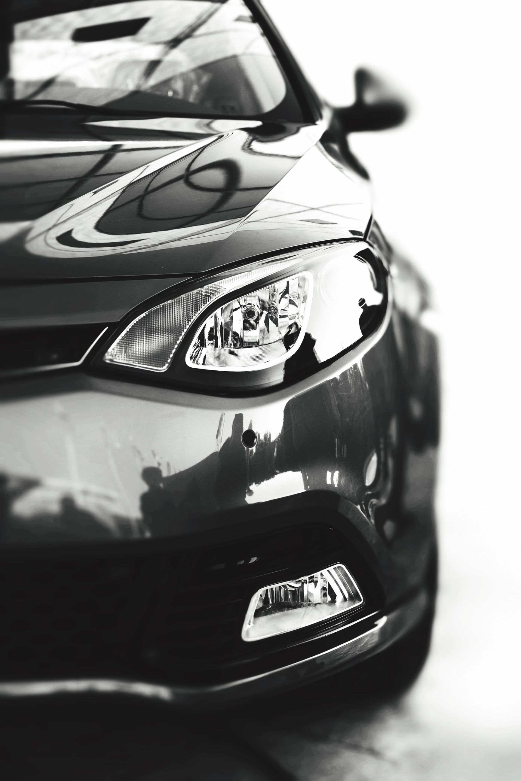 close-up, technology, music, indoors, arts culture and entertainment, photography themes, car, selective focus, transportation, musical instrument, land vehicle, retro styled, focus on foreground, mode of transport, old-fashioned, camera - photographic equipment, part of, black color, single object, still life