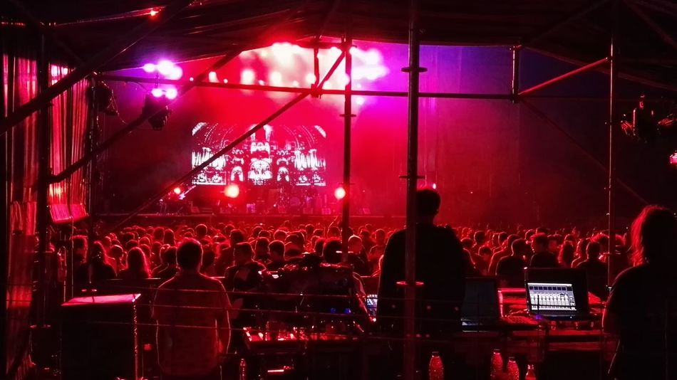 Arts Culture And Entertainment Concert Crowd Dark Enjoyment Event Group Of People Illuminated Large Group Of People Leisure Activity Lifestyles Lighting Equipment Night Nightlife People Dancing People Listening People Singing Red