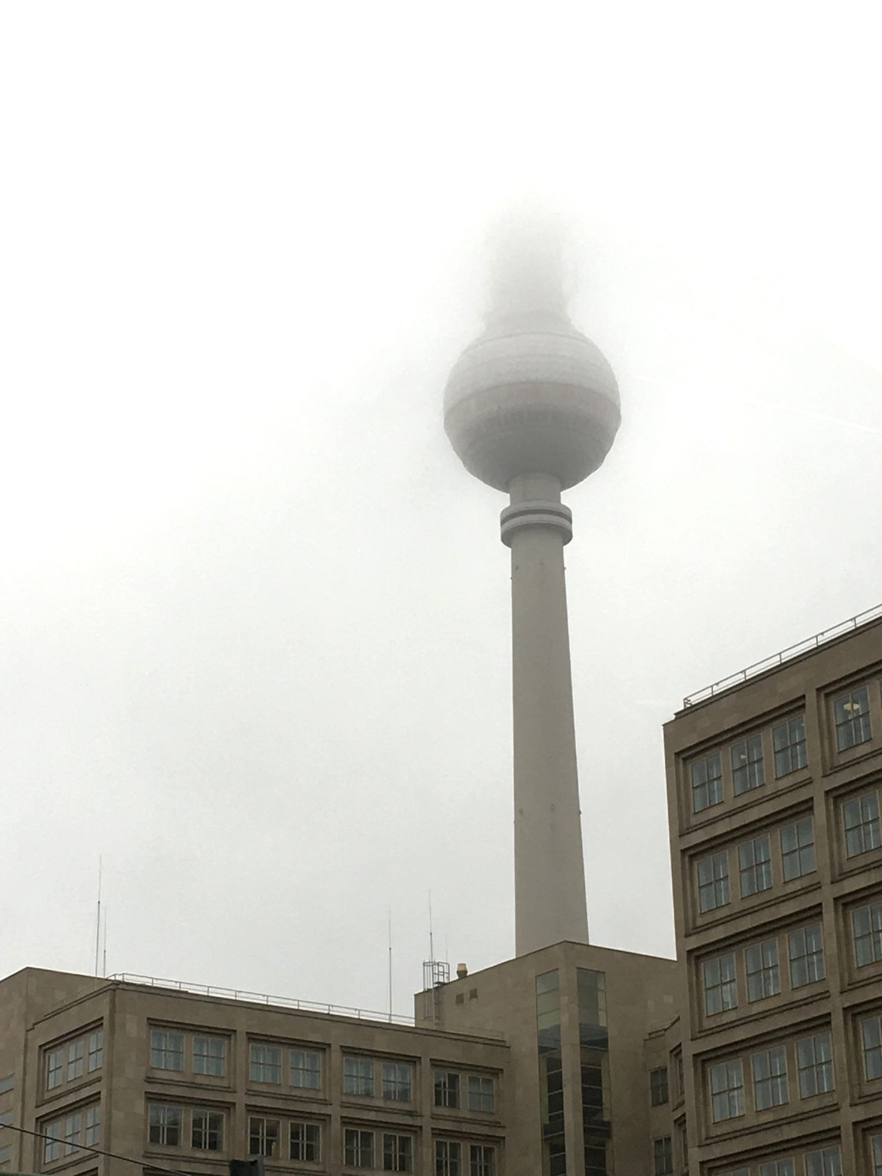 Architecture Built Structure Tower Building Exterior City Low Angle View Outdoors Day Travel Destinations No People Neighborhood Sky tower Alexanderplatz berlin Alex In Fog