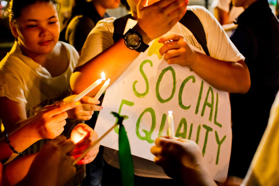 Member of a youth group, inside a university in the Philippines, light candles during a rally calling for social equality. CHRIS QUINTANA Adult Candle Candles Community Crowd Equality Equality For All Friendship GenderEquality Outdoors People Social Issues Society Women Youth Culture Youth Of Today