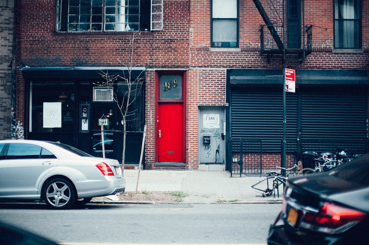 Architecture Building Exterior Built Structure Car City Building Day Land Vehicle Mode Of Transport No People NYC NYC Street NYE Outdoors Pull Downed Ga Red Bricks Red Door Road Sign Stationary Transportation Williamsburg, Brooklyn