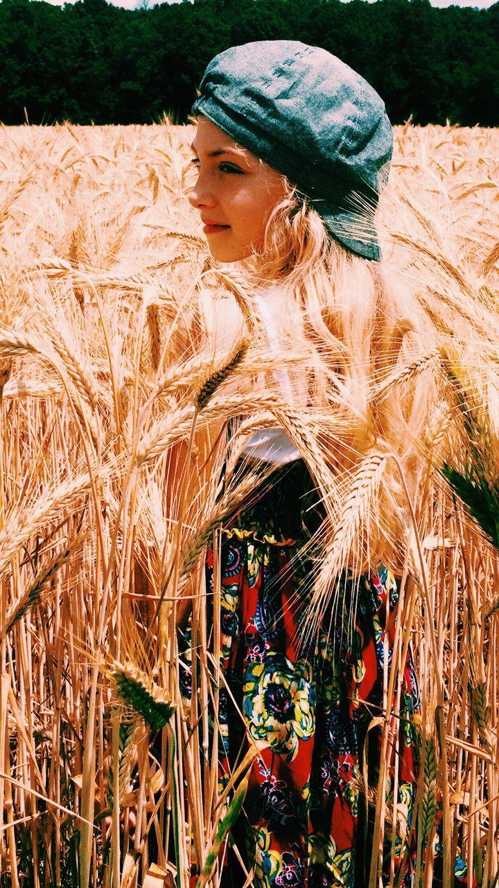 Smiling Beautiful Woman Standing On Wheat Field