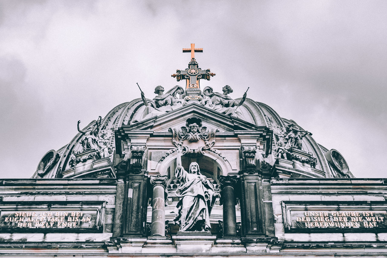 statue, low angle view, architecture, sculpture, human representation, history, sky, built structure, religion, cloud - sky, outdoors, building exterior, spirituality, day, place of worship, no people, facade