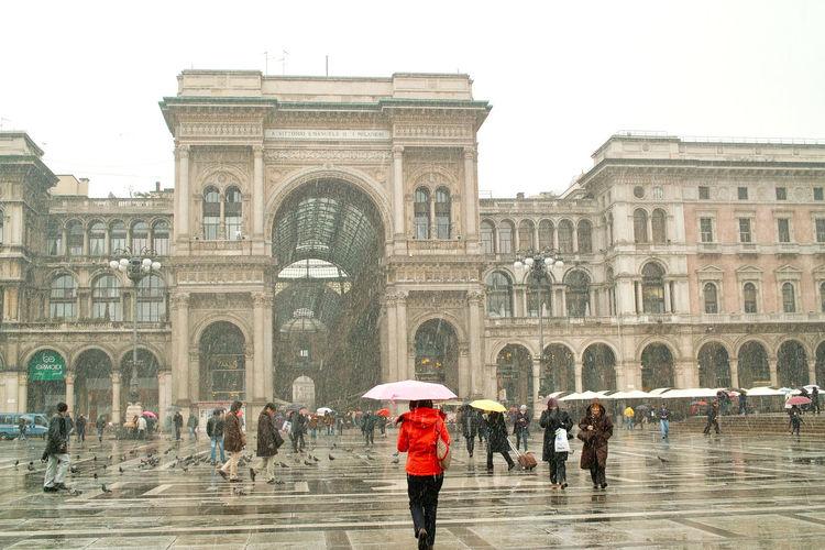 Architecture City Culture International Landmark Monument Rain Red Jacket Tourist Umbrella
