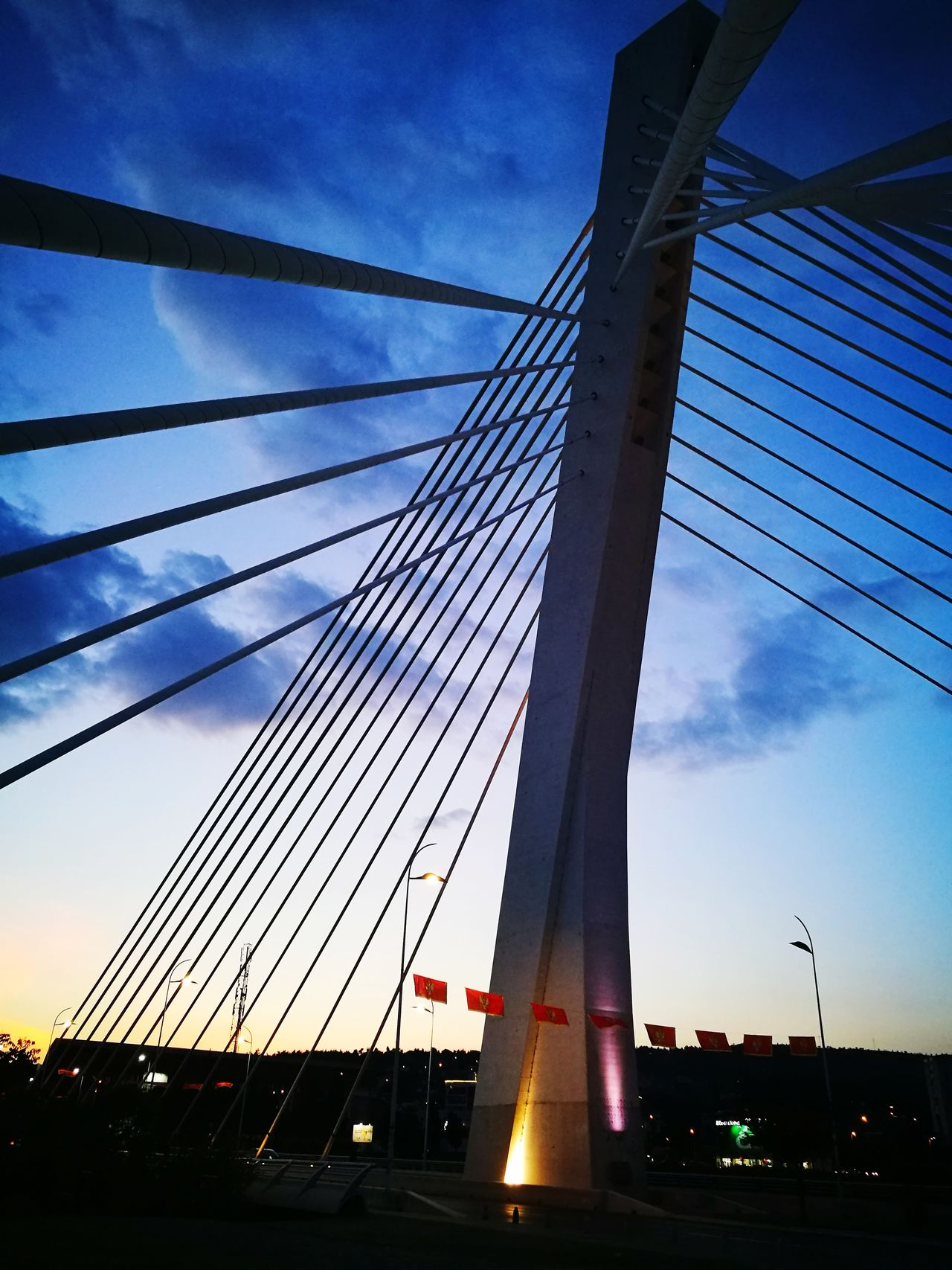 Bridge - Man Made Structure Suspension Bridge Connection Sky Architecture Built Structure Transportation City Outdoors Cloud - Sky Travel Destinations No People Sunset Low Angle View Cable Steel Skyscraper Night Illuminated Golf Club Nightshot Landscape Cityscape Podgorica Montenegro The Architect - 2017 EyeEm Awards
