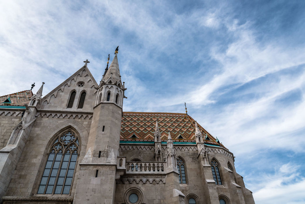 St. Mathias Church in Budapest a sunny day of summer Buda Castle Budapest Church Low Angle View Arch Architecture Building Exterior Built Structure Cloud - Sky Day History Low Angle View Mathias  Mathias Church No People Outdoors Place Of Worship Religion Sky Spirituality Travel Destinations