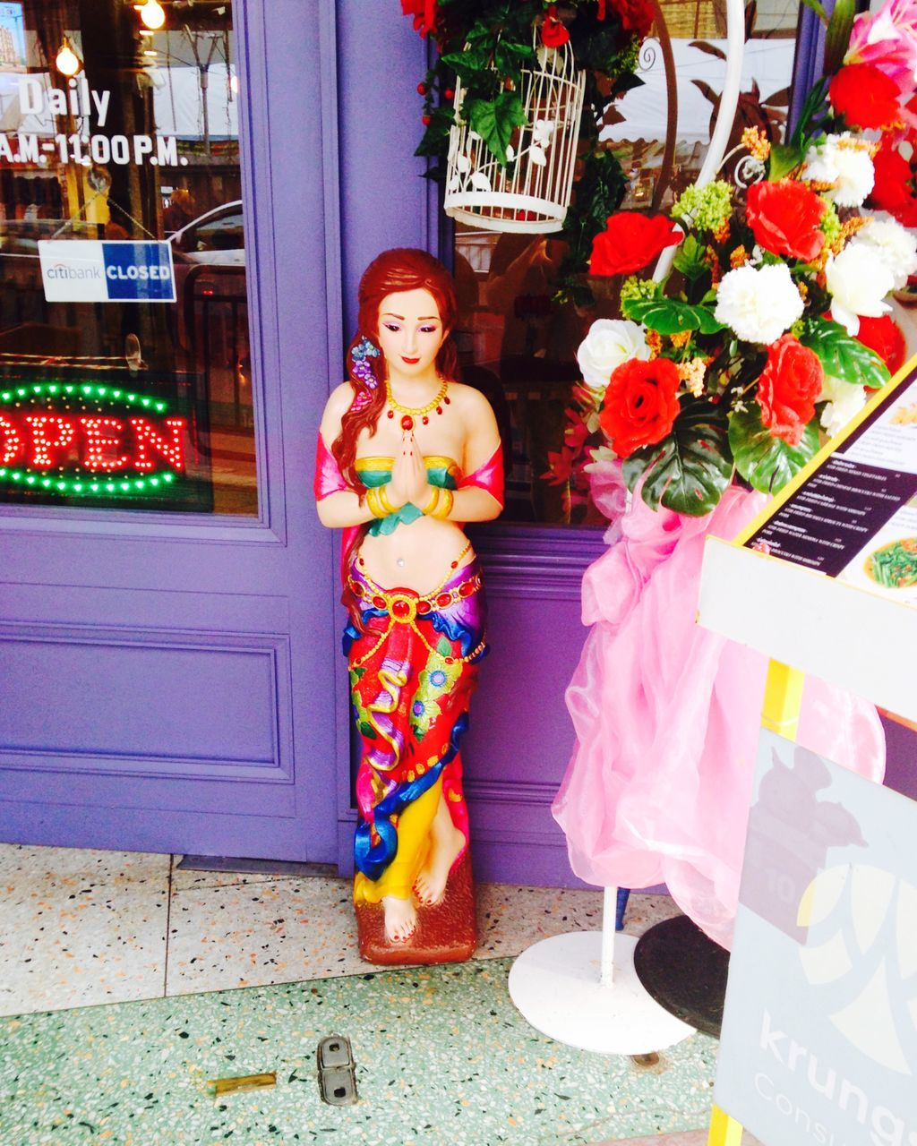 retail, for sale, store, arrangement, flower, real people, statue, outdoors, standing, full length, day, architecture