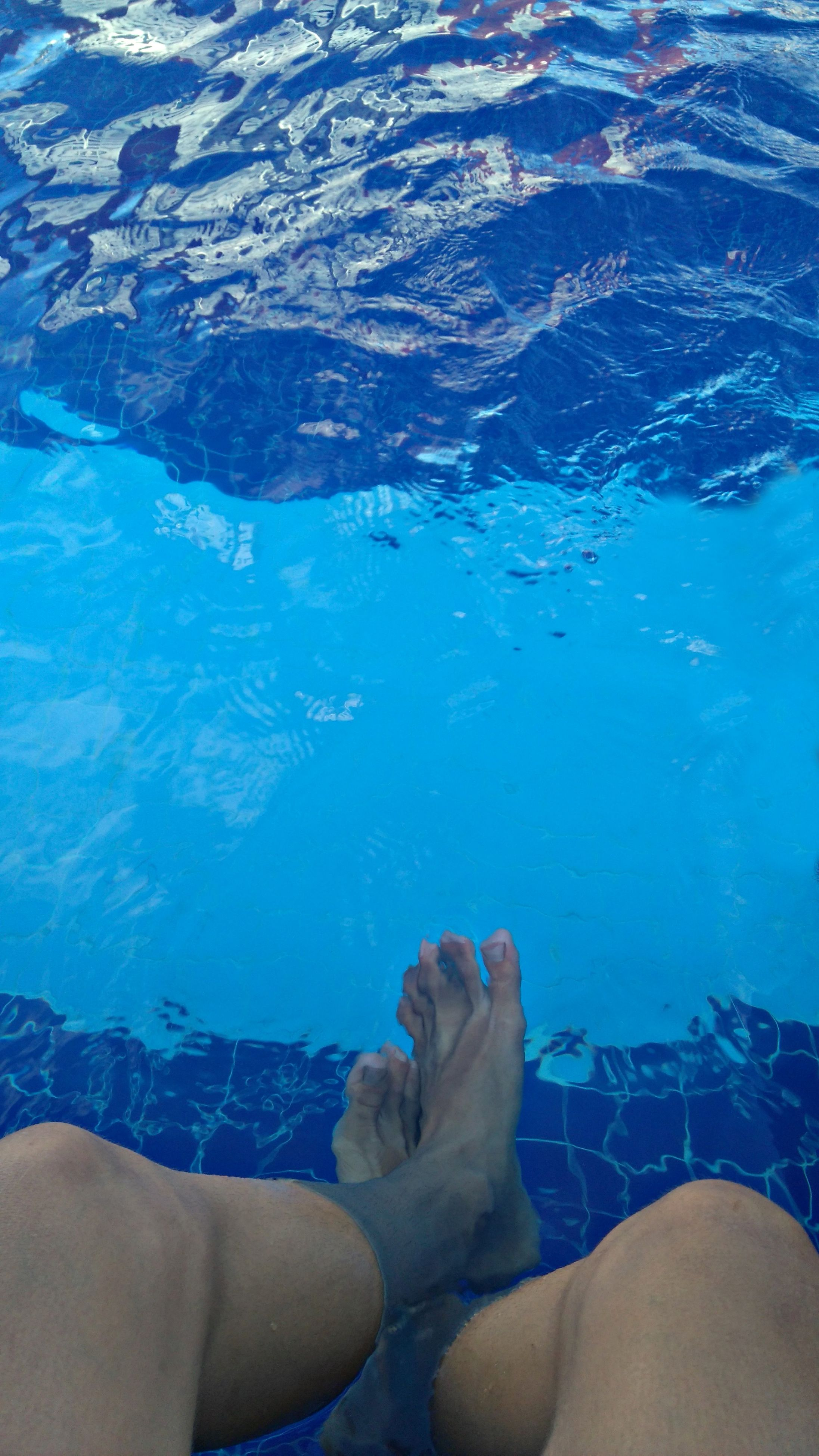 water, blue, low section, human foot, barefoot, human leg, swimming pool, underwater, lifestyles, women, real people, men, outdoors, day, togetherness, nature, one person, close-up, human body part, people, adult, undersea