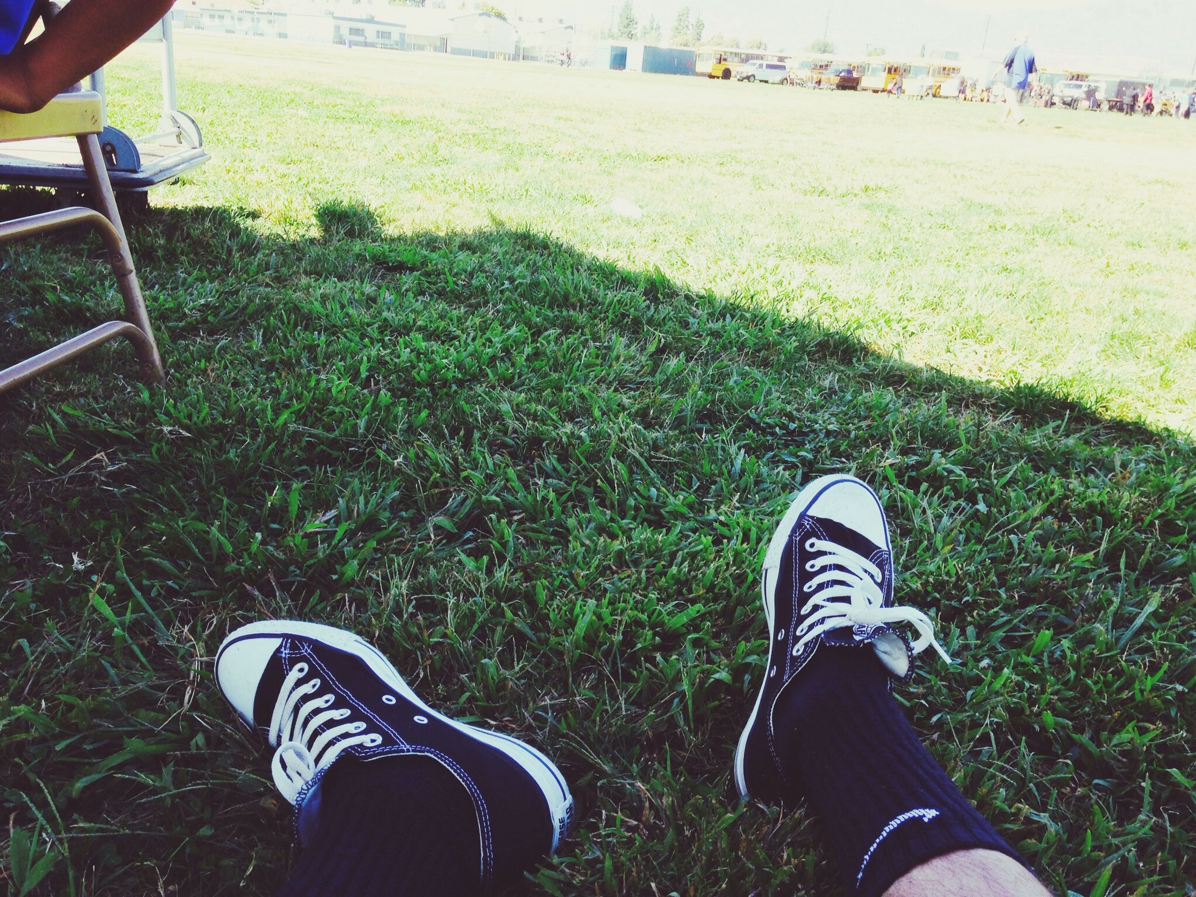 low section, grass, person, lifestyles, shoe, field, leisure activity, grassy, personal perspective, men, standing, human foot, high angle view, outdoors, day, part of