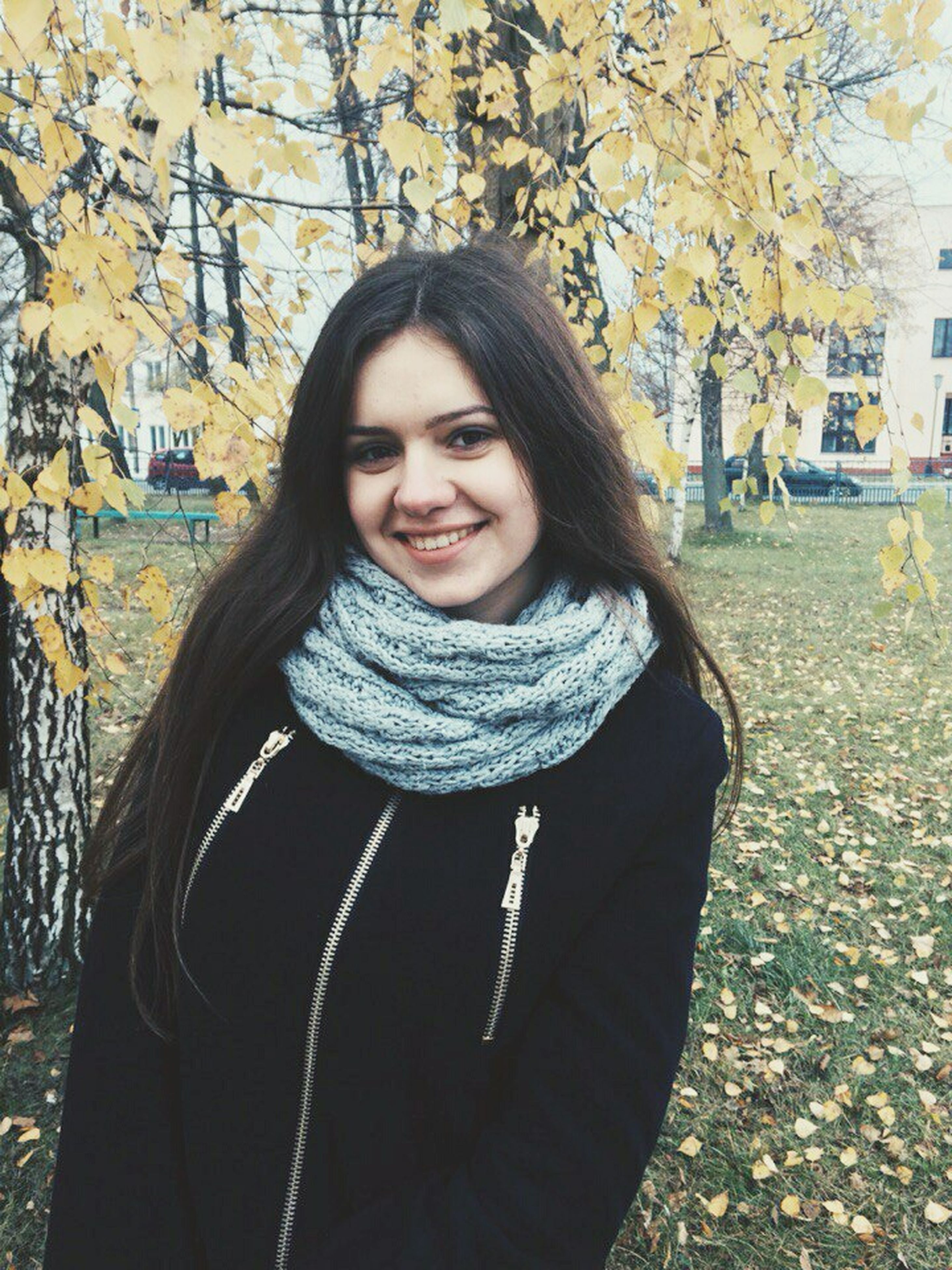 looking at camera, portrait, person, young adult, lifestyles, front view, casual clothing, young women, smiling, leisure activity, standing, long hair, tree, happiness, waist up, warm clothing, jacket