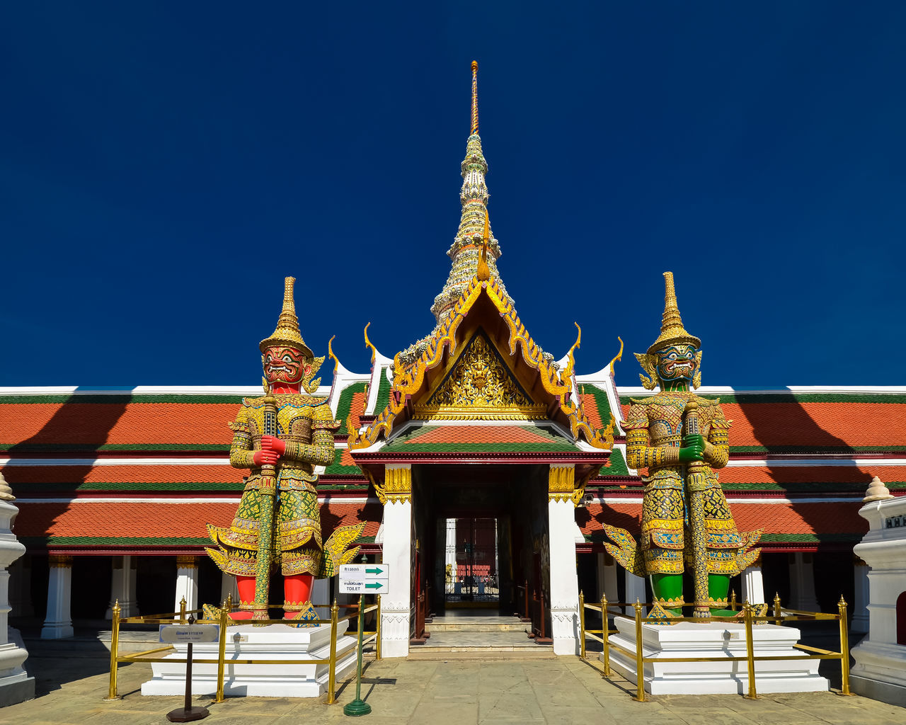 Ancient Architecture Blue Building Exterior Building Feature Built Structure Business Finance And Industry City Cultures Day Gold Gold Colored Grand Palace Bangkok Thailand History No People Outdoors Place Of Worship Religion Royalty Sky Temple Tourism Tradition Travel Travel Destinations