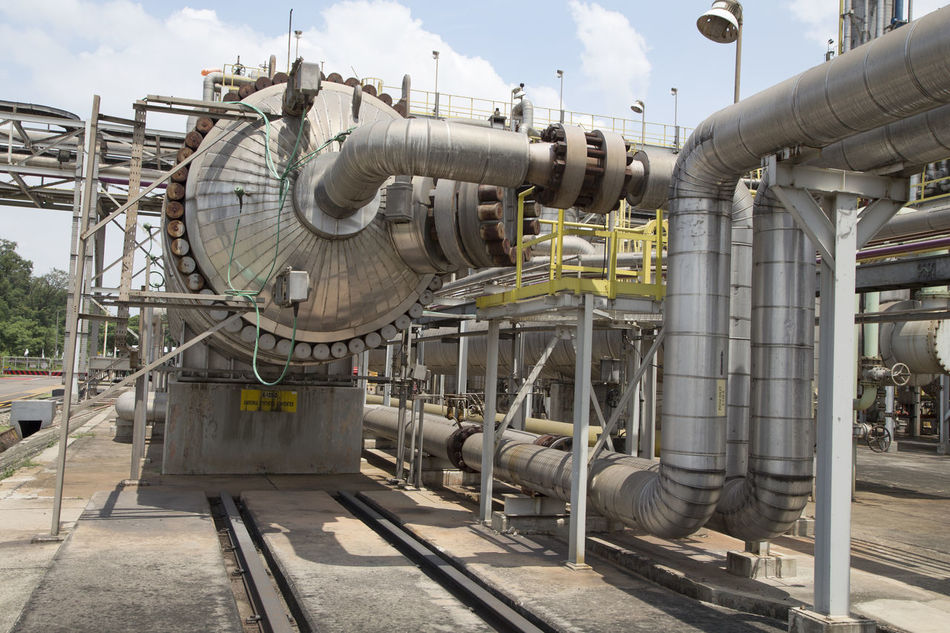 Building Exterior Built Structure Complexity Day Factory Fuel And Power Generation Industry Machine Valve Machinery Manufacturing Equipment Metal No People Oil Industry Oil Refinery Outdoors Petrochemical Plant Pipe - Tube Pipeline Power Station Refinery Technology Tube