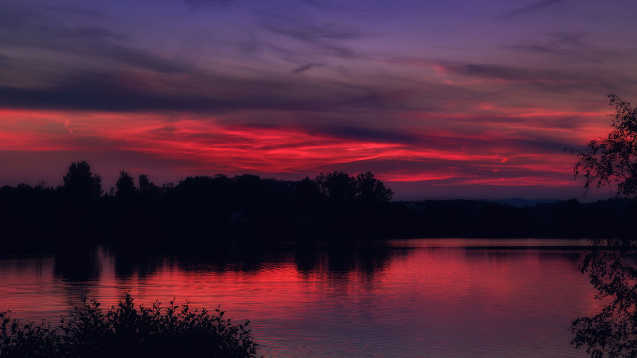 Sunset at the lake Murner See in Wackersdorf, Bavaria Beauty In Nature Cloud - Sky Growth Lake Nature No People Orange Color Outdoors Reflection Scenics Silhouette Sky Sunset Tranquil Scene Tranquility Tree Water