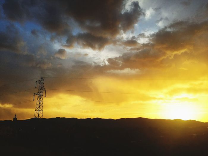 Sunset Silhouette Sky Cloud - Sky Connection Nature Scenics Beauty In Nature Tranquil Scene Tranquility Outdoors Low Angle View No People Cable Landscape Technology Electricity Pylon Day