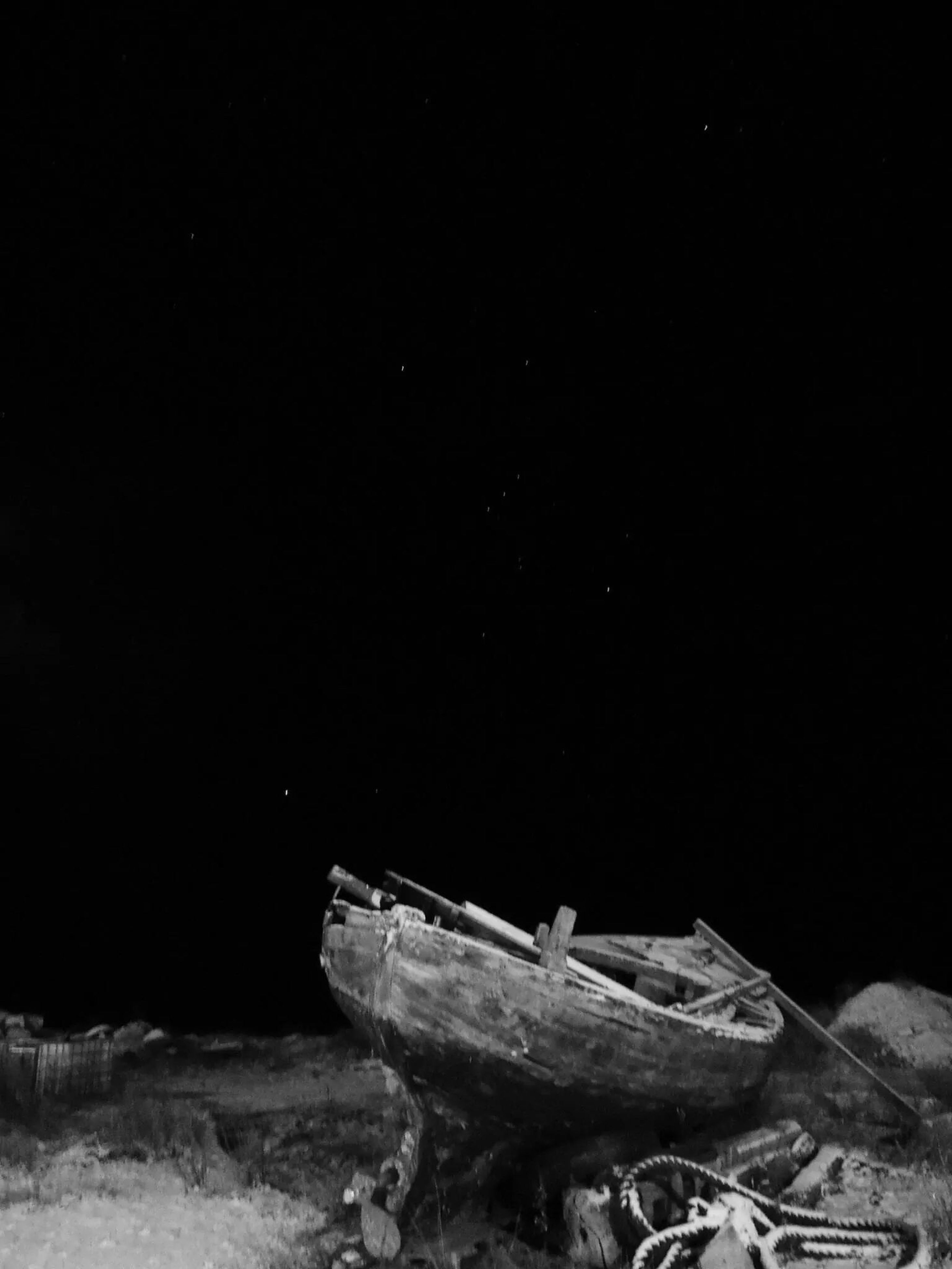 night, copy space, abandoned, clear sky, damaged, obsolete, dark, no people, outdoors, old, nature, rock - object, transportation, tranquility, deterioration, destruction, run-down, tranquil scene, wood - material, landscape